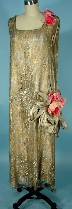 Early 1920s flapper dress of gold lame and lace, beaded with faux pearls, beads and rhinestones, with huge silk flowers