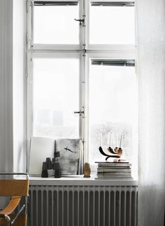 windowsills- keep it simple and minimal. stacked books, mags, pairing of vases/glass, candles, or art of varying sizes leaned up against glass