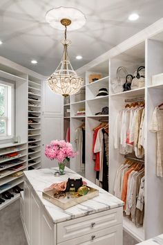 This customized closet was designed by Mosaik Design & Remodeling of Portland, Ore., to meet the needs of a couple that travels frequently. The shoe shelves were custom designed specifically for his (yes, his) large shoe collection, and the velvet-lined drawers in her island hold an enviable collection of sunglasses. A built-in ironing board and toiletry organizers are hidden behind the soft white traditional cabinetry.