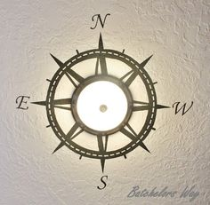 ceiling compass with 3D effect using slice of wood and metal in center