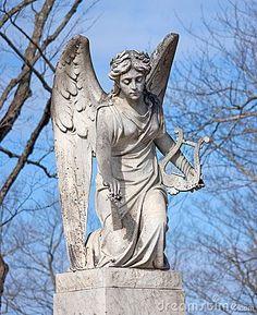 Angel Statue With Harp by Bert Folsom, via Dreamstime