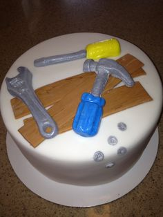 Handy man special cake, tools, renovator, hammer, wrench, screwdriver, nuts and bolts, birthday cake