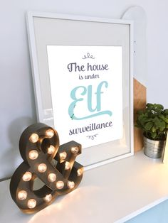 Elves exist, did you know that? Find one on this funny poster — it will bring even more joy and smiles into your home on Christmas. Just print it out, hand on a wall, and enjoy!  #christmas #holidaydecor #holiday #decor #elf #underelfsurveillance