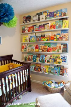 playroom! I love this :) Such a cute and creative idea!! Great for Organizational purposes to :))) You can put the super special books you dont want them to get to and ruin as a baby/toddler on the higher shelves...DOIN IT!!!!