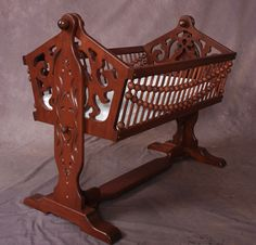 I don't necessarily like all the extra details but I like the design with the stable base but still rock-able :). Victorian wooden baby cradles and wooden rocking horses by Childwood Products