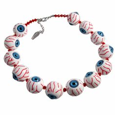 Creepy eyeball necklace Red Stripe Clothing. It reminds me so much of the eyeball necklace in Secret of Monkey Island