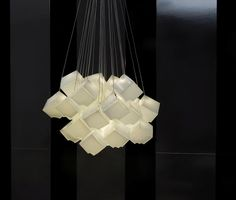Noga Noya | The elegant warm light appears to melt one ice cube into the next forming an artful cluster of suspended dice.