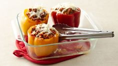 Enjoy your dinner with peppers that are stuffed with ground beef and baked to perfection.