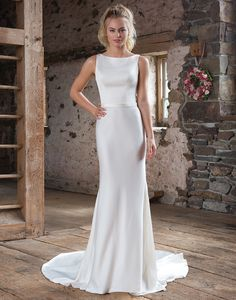 Sweetheart Gowns 1104 Ivory Size 10 A sweet and simple gown with flirty back details. This high-neck style has a simple belted waist, a square-cut illusion lace back and feminine slim a-line gown. https://www.sweetheartgowns.com/sweetheart/1104