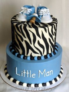 Boy baby shower cake with zebra print and fondant Converse shoes and pacifier.