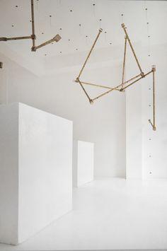 Ghaith & Jad / brass rod installation inside Beirut boutique