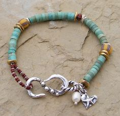 Not loving the clasp, but love the colors on this bracelet
