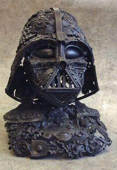 Darth Vader made from household junk. It starts with two spoons for the eyes.