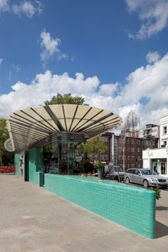 WESTBOURNE GROVE PUBLIC LAVATORIES EXTERIOR SHOWING ENTRANCE DOORS WITH FULL LENGTH MALE AND FEMALE