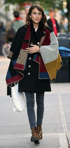 Switching it up: Later that afternoon, Alexa donned a chic Burberry poncho, which she paired with skinny jeans