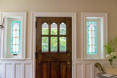 Stained glass flanking restored front door