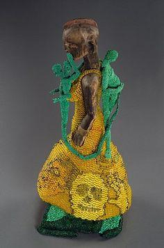 Joyce J. Scott, Shhhhh! sculpture, Nigerian wooden object, plastic and glass beads, thread, and fabric