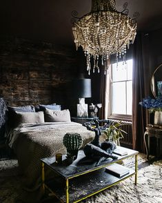 Play with textures and layers to create a sense of luxury and glam within your pad (and a chandelier always helps!) #interiordesign #interiors #bedroom
