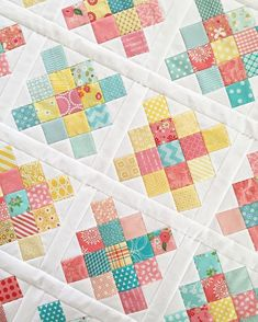"""(Part 3) My most recent project using my 2.5"""" leftover squares is a granny square quilt.  I had way too many blues, pinks, and yellows so it was time to use them!  I love the look of a scrappy granny square block.  You can see more about how I store my scraps on my blog post from today. (Link in profile)  #scraps #leftovers #grannysquares #grannysquarequilt"""