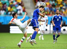 Khosro Heydari of Iran challenges Emir Spahic of Bosnia and Herzegovina during the 2014 FIFA World Cup Brazil Group F match between Bosnia and Herzegovina and Iran at Arena Fonte Nova on June 25, 2014 in Salvador, Brazil.