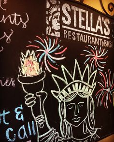 https://flic.kr/p/JZ5fe6 | Blackboard at Stella's | Bought a pizza from Stella's to support a fundraiser for a performing arts school.  While I was waiting for my pizza to go, I took a picture of their chalkboard with a drawing of the Statue of Liberty on it.