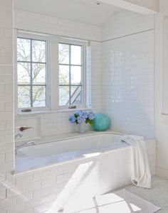 Beautiful all-white bathroom with white subway tiled bath nook with thin gray tiled accent band and drop-in tub with marble tub desk. The bathroom floors are tiled in marble mosaic and layered with a white bath mat. Home Design, Luxury Interior Design, Interior Exterior, Design Ideas, Beach Design, Interior Modern, Design Styles, Modern Furniture, Bad Inspiration