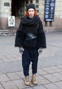 "Natanya, 30  ""I'm wearing a H&M beanie, scarf and trousers by JNBY, fur coat from a street market, a belt by Comme des Garçons and Dockers shoes.""  18 January 2014, Mannerheimintie"