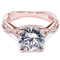 I have never seen an engagement ring Rose gold but this is just stunning!