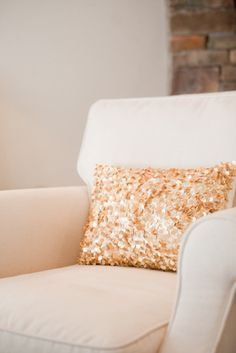 I keep a couple of sparkly pillows out year 'round.  You don't have to save them only for the holidays!