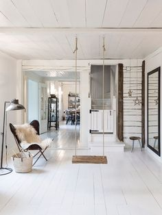 I love my swing chair, but I also love the idea of just a plain old swing, given the space to actually swing in. ~ETS (Indoor swing in a charming family home in the Finnish countryside - Photo Carina Olander / styling Anna truelsen. Scandinavian Interior Design, Scandinavian Living, Home Interior Design, Swing Indoor, Style At Home, Living Room With Fireplace, Home And Family, House Design, Home Deco