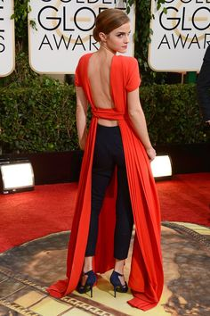 Emma Watson wore an outfit from the Dior Couture collection – a red backless dress with slim black trousers – accessorised with Roger Vivier heels and Dior pearl earrings. Golden Globes 2014 Dresses – Red Carpet Dresses and Outfits (Vogue.com UK)