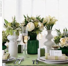 white + green centerpieces in milk glass and mixed containers