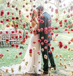 Wedding Day cheap wedding decorations wall of red flowers behind which the kiss of the bride and groom cara robbins studio - Elegant doesn't mean expensive. You can make unique and cheap wedding decorations. Mumu Wedding, Wedding Goals, Chic Wedding, Perfect Wedding, Fall Wedding, Wedding Ceremony, Dream Wedding, Luxury Wedding, Ceremony Arch