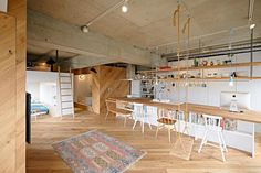 Tenhachi Architects stripped an old apartment in Kanagawa down to its core, to remodel it for their family home. The room is organized in open boxes and walls that don't reach the ceiling allowing all areas to be connected.