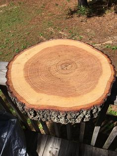 Wood slab cake stand with beautiful bark!  This wood slab cake stand you see in the photo is from a 14 wood slab! You can choose during checkout between sizes ranging from 12-18 in diameter! Each wood slab will come cut from a hardwood tree and will be between 2-4 thick.  Please note that all orders of a size larger than 14 will not come planed (my planer only planes 14 wood and below.) So if you order a wood slab 15 or above, it will be cut with my chain saw, then sanded (pics. #3&4 show...