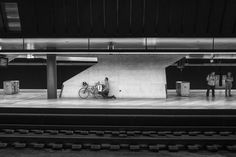 Worship the mobile Laptop Mount. Man kneeling behind his bicycle and using a laptop standing on the carrier. The scene is an underground train station with lots Man Kneeling, Street Pictures, Laptop Stand, Train Station, Worship, Pictures