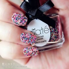 There goes those sprinkle nails again!