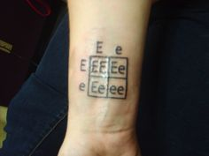 people are nerds and people are awesome. punnett square tattoo. link goes to discover magazine's science tattoo emporium.