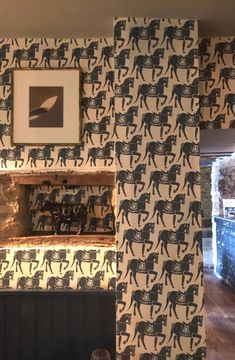Majestic horses trot symmetrically round this room with this fabulous wallpaper from Molly Mahon.  Click link to buy.