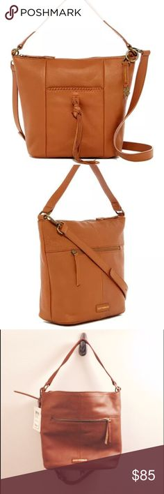 Lucky Brand Carmen hobo bag in tobacco leather This is the perfect cognac leather bag for every day! It's roomy and has tons of pockets while still being lightweight and not overwhelming. The leather is soft and there's an exterior pocket on either side, with a leather tassel on one, plus a long, adjustable crossbody strap (only flaw is a slight chip there, shown, and I've punched an extra higher hole). Top zip. New with tags and unused--I have a similar bag that works better for me but had…