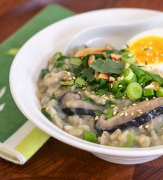 Brown Rice Congee with Shiitake Mushrooms and Greens | Use grapeseed oil in lieu of vegetable oil to sautee. If you use vegetable stock, make your own. Opt for salt instead of soy sauce and use in moderation.