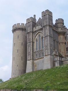 Arundel Castle, West Sussex, England.  Those narrow windows in the tower are probably dual purpose for archers and to let in light.  .:.  .:.  see also:  http://snow.Energy526.com