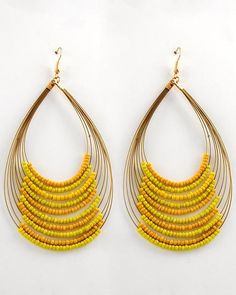 I'd need at least a bottle of wine to try something like this. // Zuri Yellow Beaded Earrings