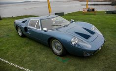 1967 Ford GT40 M3/1101 Mark III  Ford built seven GT40 Mark IIIs for road use with wire wheels, door glass, lights, mirrors, a luggage compartment, and small bumpers. The first car in this series appeared in left-hand-drive form at the 1967 New York auto show and has been carefully restored to its original configuration. The current owner is Kurt Engelhorn of Saint Moritz, Switzerland.
