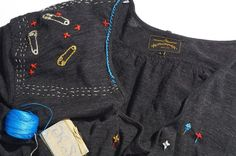 The fun safety pins embroidered also hide damage on this Punk Dress Punk Dress, Visible Mending, Blue Blanket, Blanket Stitch, Old T Shirts, Vivienne Westwood, Sewing, Safety Pins, Embroidery Ideas