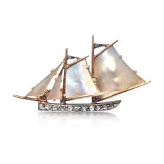 An Antique, Gold, Diamond and Mother of Pearl Sailboat Brooch - Sold