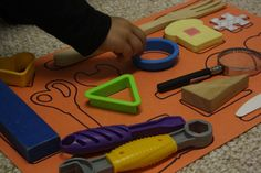 Do it yourself matching games from Happy Hooligans.  Pairing objects with their shapes is a great cognitive skill builder.  Use fewer shapes for younger children, increase the number as they master the skill.