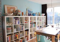 Looking for an unformal dining room idea suitable for the kids? Try this simple and artsy look: For an instant playroom, bring in a couple of storage units for organization. Choose a table that isn't too delicate and looks better after a few beatings. Remember the worn look is on-trend these days. When company comes for dinner, cover table with a pretty tablecloth and scrub crayon markings from the wall. Last, add ambiance. Everything looks better in candlelight.