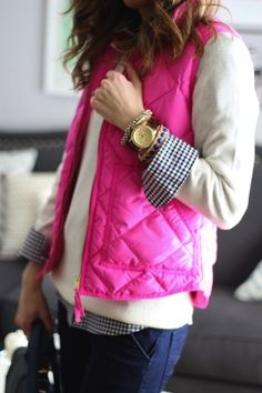cream sweater over a gingham shirt with a bright vest
