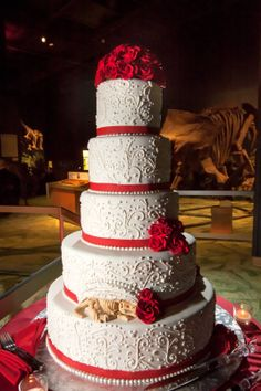 Traditional Red and White wedding cake with hidden chocolate dinosaur to surprise the Groom...